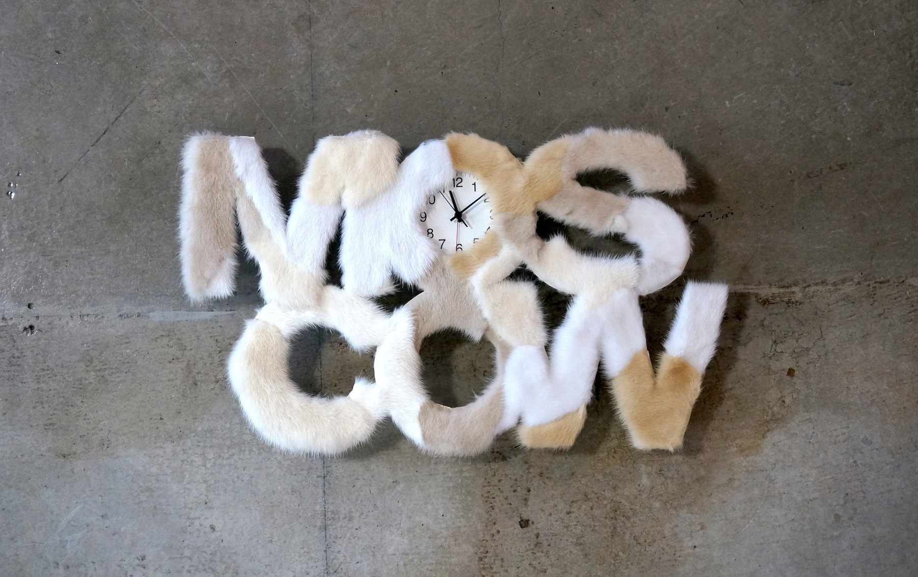 """Product """"Moscow"""" - Clock with recycled mink decoration. Designed by Masaki Kato / PUDDLE INC."""